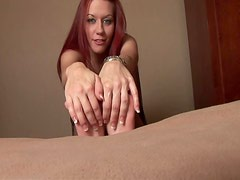 Smiley redhead rubs lotion on her cute feet