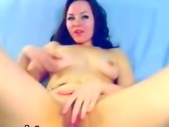 Sexy brunette fingers and toys her wet pussy