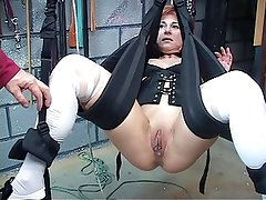 Cute, mature redhead gets her pussy toyed with in a sex swing