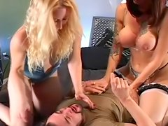 Two hot babes sitting on the face of their shared boyfriend