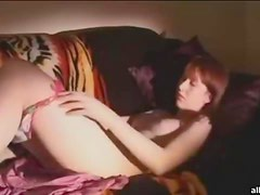 Adorable redhead amateur cutie rubs her pink pussy
