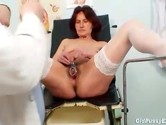 He goes into her pussy with a speculum