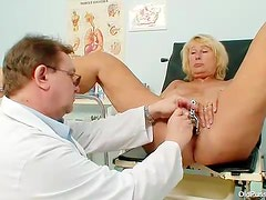 Doctor does a thorough exam with blonde mature