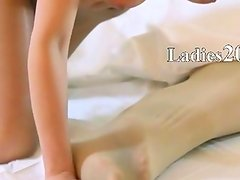 Horny young girls with strapon on couch