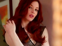 Seductive redhead playing with herself
