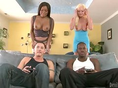 Watching TV together turns into foursome interracial banging