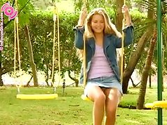 Blonde Girl Peeing While She's On The Swings.