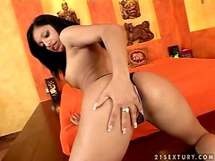 Exotic babe Kyra Black boffs herself with a thick dildo