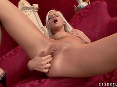 Adorable blonde chick toys her tight ass with a dildo