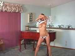 Jaden Lee the slim Asian girl undresses near the grand piano
