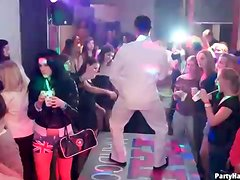 Girls fool around with the dancing guys at club