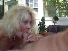 Amateur blonde cougar strokes younger mans cock