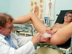 Speculum in the pussy with a light following