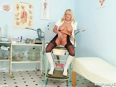 Old lady in boots and stockings masturbates pussy