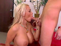 Very sexy Holly Halston seduces Sonny Hicks with her adorable huge tits and she sucks his boner with lust