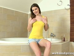 Diving Xenia has fun playing with her piss