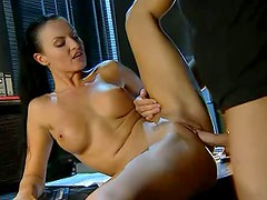 Naughty dark haired beauty gets fucked in the office