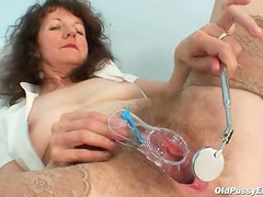 Old pussy is hot with speculum inside
