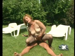 Hairy mature in stockings fucked outdoors
