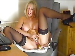 Blonde MILF In Stockings Toying At The Computer