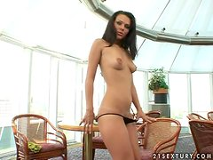 Brunette hottie Katty N. strips and plays with her shaved pussy