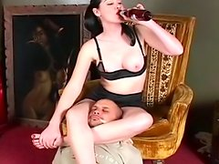 Smoking brunette is sitting on the face