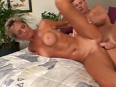 Mature cocksucker with big tits fucked