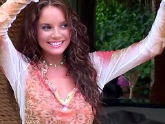 Curly-haired cutie Hillary Fisher poses nude in the garden