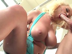 Tattooed blonde Angel Vain with huge boobs sucking and licking Johnny Sins tool