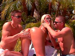 Busty Bridgette B. is pleasuring Mick Blue and Toni Ribas hard peckers simultaneously