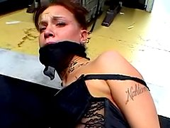 Tied brunette with red gag in mouth