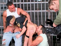 Jessica Moore gets double penetrated in a jail. Behind-the-scenes video