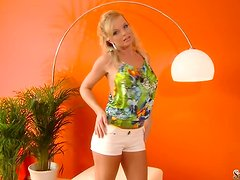Hot blonde Silvia Saint strips and shows her goods