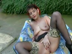 Trashy women play lustily outdoors