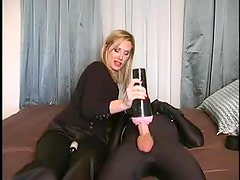 Mistress arouses her submissive with sex toy