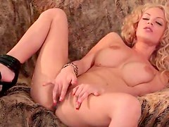 Big titty chick with curly hair masturbates