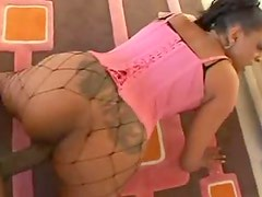 Tattooed black beauty in corset fucked hard