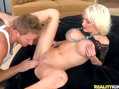 Kinzie is a beautiful blond MILF with big boobs and