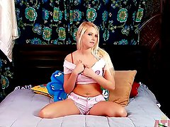 Blonde Vanessa Cage answers questions and masturbation in front of the stationary camera