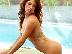Sexy babe Mandie Sue takes her bright bikini off and poses for the cam