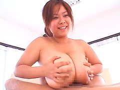 Huge Japanese boobs girl gives titjob