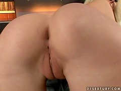Luscious Kittie fingers and toys her pussy with golden dildo