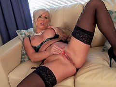 Office blonde Charlie Z masturbates in close-up