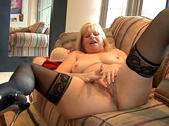 Mature blonde Dawn Jilling poses on high heels