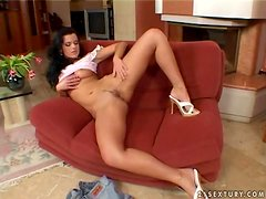 Juditta strips and plays with her nice shaved pussy