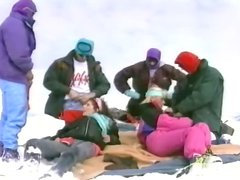 Group of people having an outdoor orgy at the ski resort