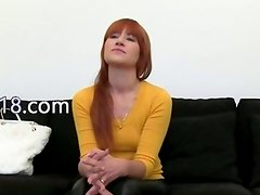 Redhead princess tease on black couch