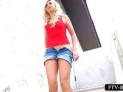 Sex doll blonde masturbates with vibrator in public