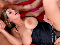 Babe with bug tits is sucking two horny dicks
