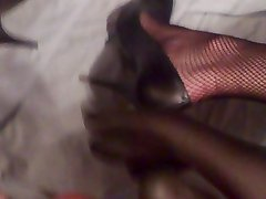 crossdresser playing with cock in heels and fishnets